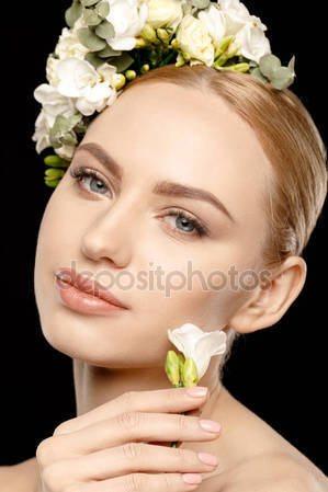 depositphotos_141137248-stock-photo-woman-with-flowers-in-hair